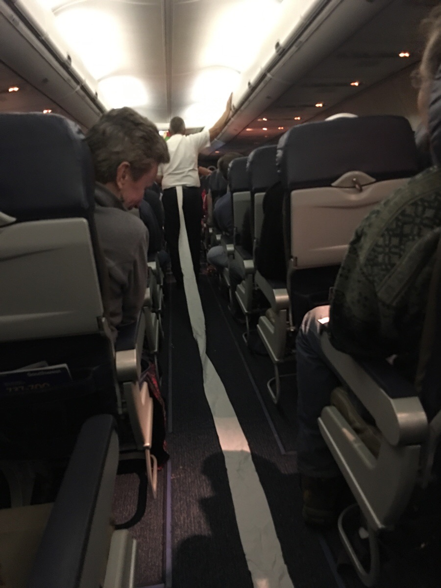 The flight attendant rushed out of the bathroom